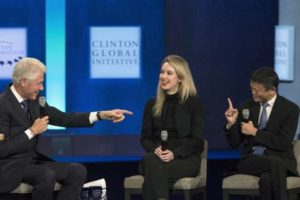 Former U.S. President Bill Clinton (L) speaks with Jack Ma (R), executive chairman of Alibaba Group, and Elizabeth Holmes, CEO of Theranos, during the Clinton Global Initiative's annual meeting in New York, September 29, 2015.  REUTERS/Brendan McDermid  - RTS2BYH