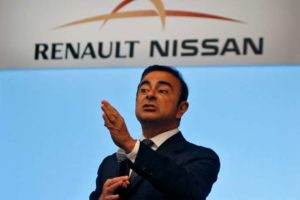 Carlos Ghosn, chairman and CEO of the Renault-Nissan Alliance, gestures as he speaks at a news conference in the southern Indian city of Chennai July 16, 2013. REUTERS/Babu (INDIA - Tags: BUSINESS TRANSPORT) - RTX11O8S