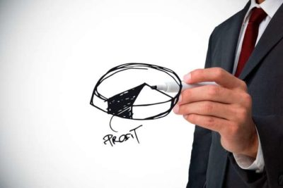 Composite image of businessman drawing pie chart